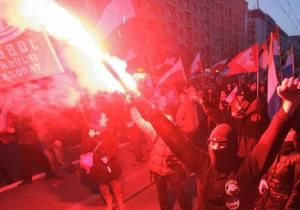 Young Poles torched cars, threw stones at police and tried to climb the fence at the Russian Embassy after setting a guard's booth ablaze during a march Monday by nationalists marking Poland's Independence Day.