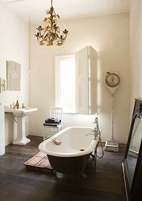 I fell for this bathroom; the vintage scale, duck board, and dark floor, but most of all - for me - the shutters.