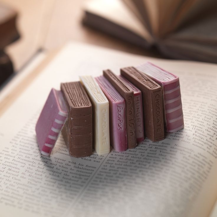 Chocolate Miniature Books - Love reading? Love chocolate? Then these perfect mini chocolate books are a must. These novel little chocolate books, made of luxurious milk and white chocolate. are an ideal gift for the bookworm in your life. This little edible library makes a super addition to the traditional book token gift, or as an extra special treat for yourself as you curl up in front of the fire with a good book!  Handmade from a blend of Belgian white, milk & dark chocolate Colo...