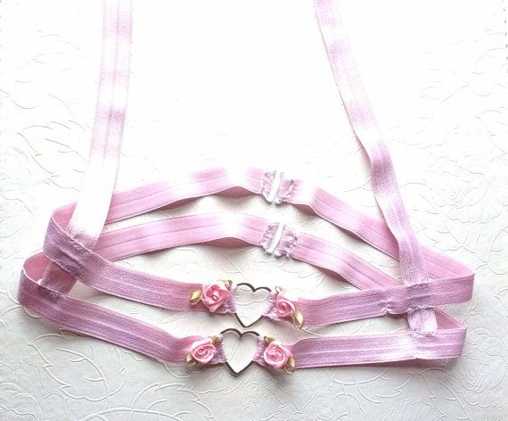 Hello lovelies, This comes in pink/red/black Two rows of hearts and roses just under the under bust Hooks in the back for easy time