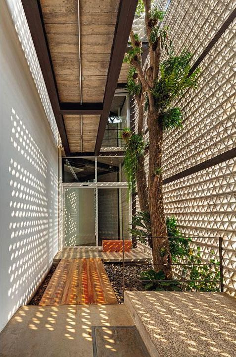 Use patterned cut out screening for nice shadows. La Tallera Siqueiros Museum (2010) / Frida Escobedo © Rafael Gamo