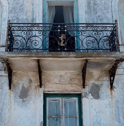 Old house with its faded facade.. Spetses Island, Greece