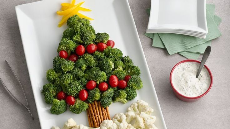 "Christmas Tree Vegetable Platter | A broccoli and tomato ""tree"" with pretzel ""trunk"" and cauliflower ""snow"" are delicious dippers for a cool and creamy dip."