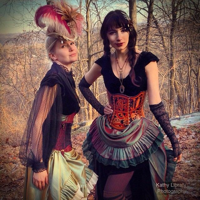 Two brave #models posing in frigid temperatures for #steampunk  #photo in upstate #newYork #elisalovelie  #stunning #vista #feather #hat #corsetry #cosplay #victorian #style #moresca #kathyLibratyPhotography