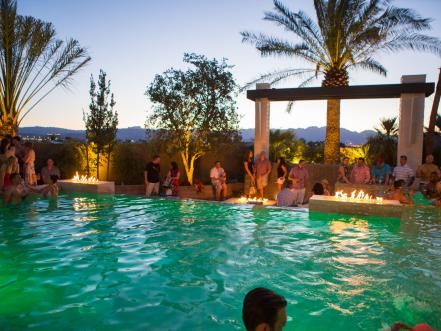 Built-in fire features create a dramatic contrast at dusk, making this pool perfect for parties.