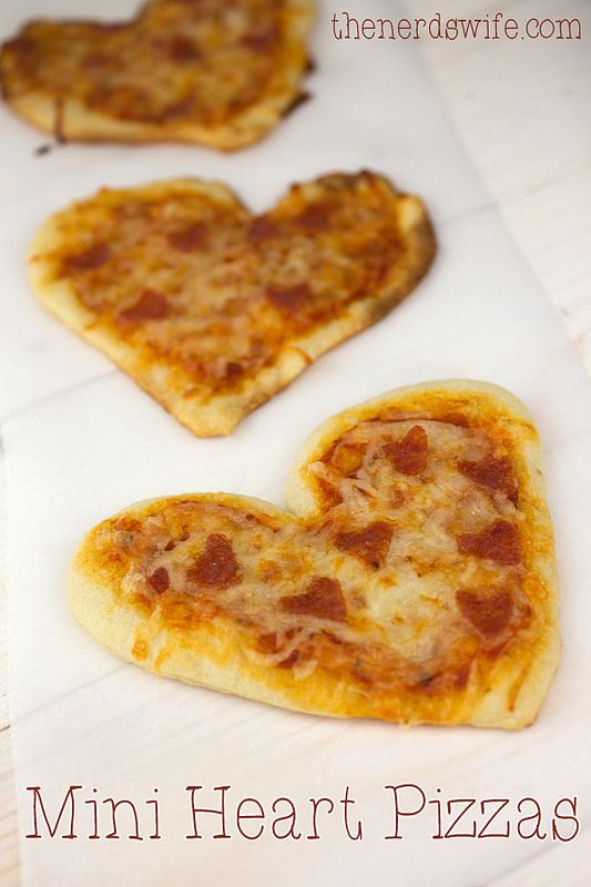 Mini Heart Pizzas - heart-shaped dough with heart-shaped pepperonis - a fun meal to serve on Valentine's Day!