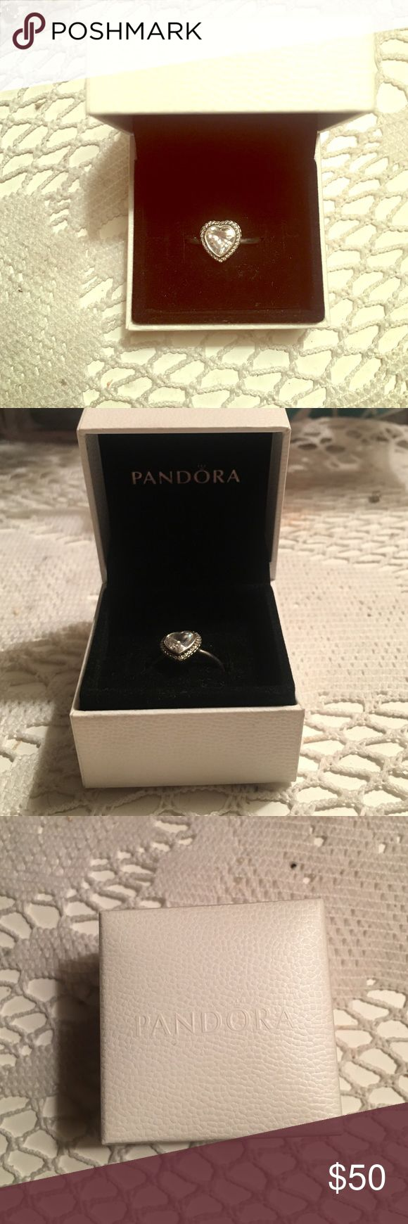 Pandora Sparking Love Heart Ring! A large heart-shaped cubic zirconia framed by a halo of tiny cubic zirconia stones makes this sterling silver ring an elegant statement piece for both every day and special occasions. Kept in very good condition! Pandora Jewelry Rings