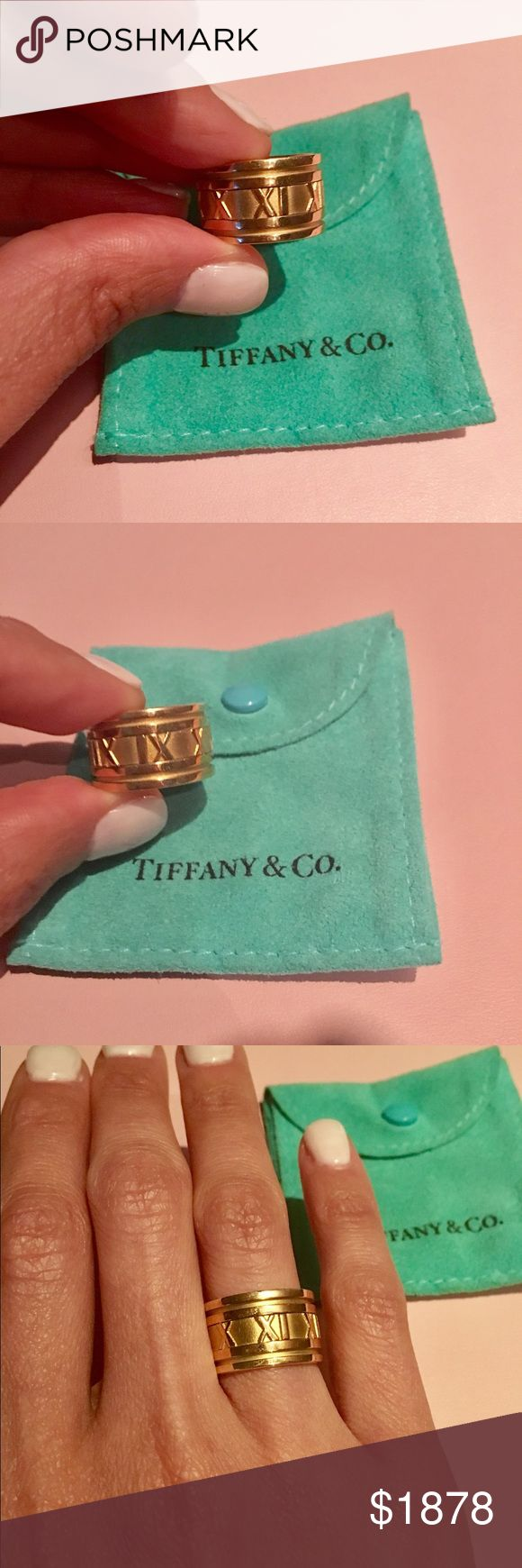 Tiffany & Co. 18K Yellow Atlas wide band ring-sz 6 Tiffany & Co. 18K yellow gold Atlas Roman Numeral Wide band ring size 6.  Hallmark stamped inside: Tiffany & Co. 1995 750 Italy. Roman numeral design Crafted of lustrous 18-karat yellow gold, this Atlas ring features a polished finish Carved ring features a polished finish with matte accents. Band measures 12 mm wide x 1.8 mm thick This unique piece is estate jewelry, which means previously owned. Slight wear & tear surface scuffs, which…