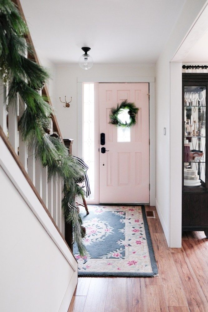 Using a pine garland from Home Depot to make 3 wreaths - so easy and such realistic faux holiday greens! #holidaydecor #christmasdecor #pinkdoor