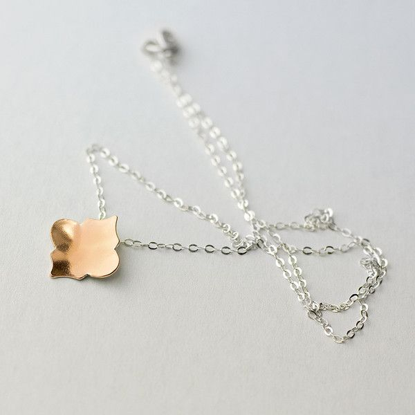 Minimalist and ornate at the same time, this bright and charming copper and silver pendant is exceptionally wearable.