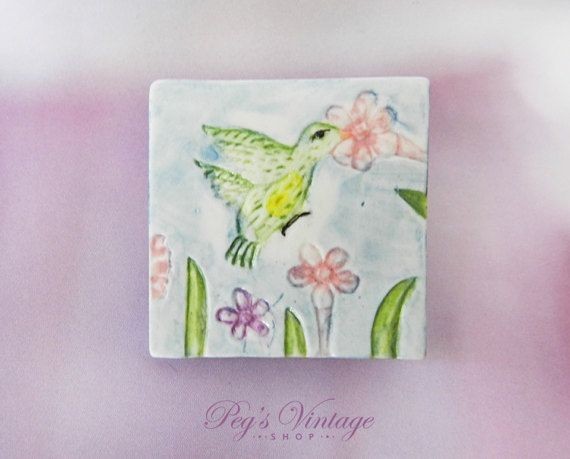 Check out this item in my Etsy shop https://www.etsy.com/ca/listing/497402278/vintage-porcelain-hummingbird-brooch
