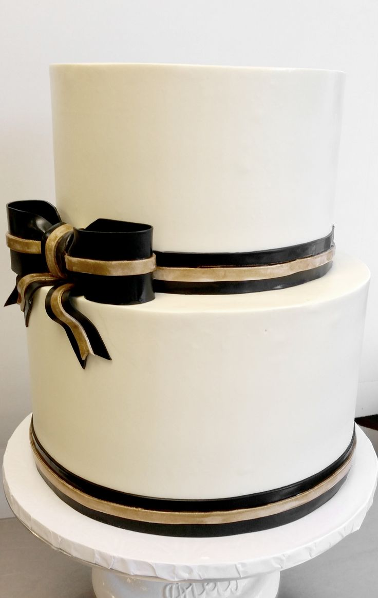 Petite wedding cake with fondant black and gold ribbon detail (2-tier, buttercream)