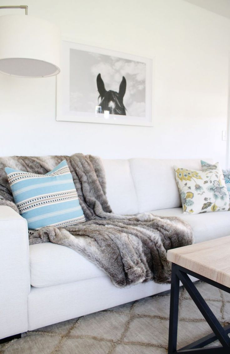 faux fur throw styled on the sofa