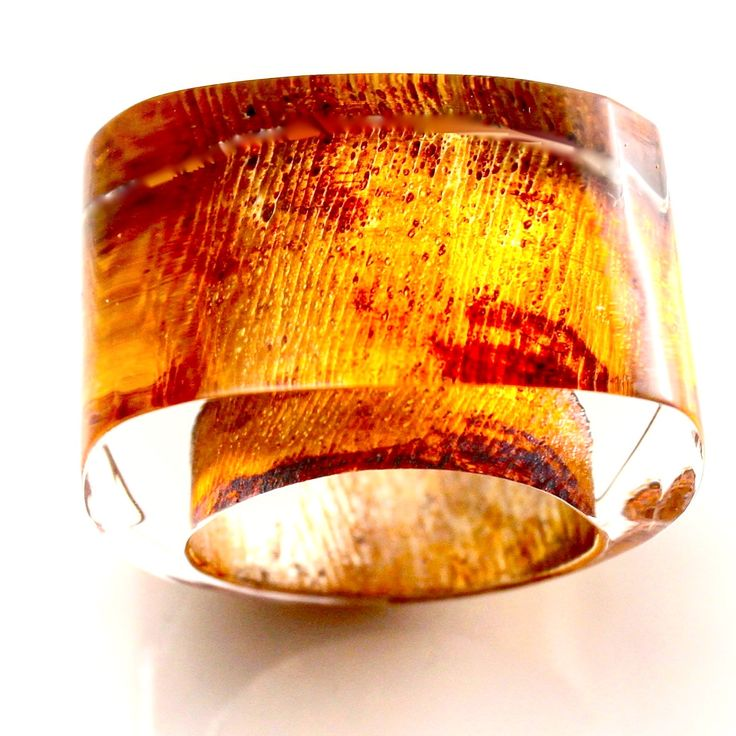 Glowing Amber metallic finish. From new ring collection.
