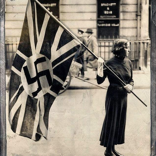 The flag of the British Fascist Party was ordered to be removed from outside the party's headquarters, London. 1933 . . . . #flag #british #britain #england #brexit #london #fascism #party #headquarters #racism #girl #Girls #women #woman #female #black #white #blackandwhite #pic #picture #image #foto #photo #photography #photograph #photographie #photographer