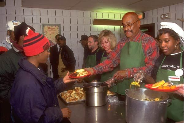 Volunteer at a soup kitchen.