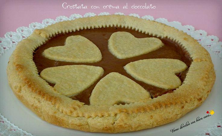 da buona golosona non posso far altro che accontentarlo visto che adoro anch'io le crostate! ho optato per una crostata con crema al cioccolato