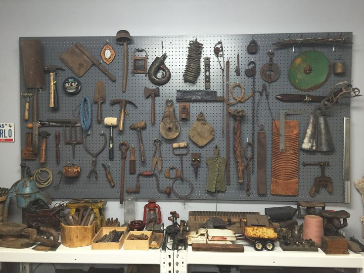 Paint pegboard a steel gray color to give an industrial look. Display old tools and found objects to create a dramatic wall.