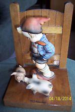 M J Hummel pig boy book end.