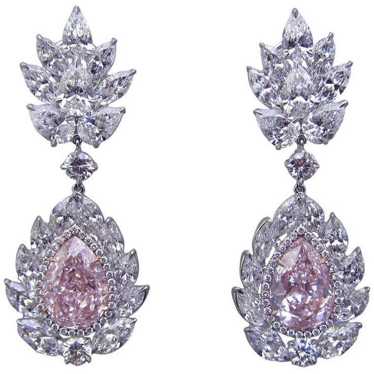Magnificent  G.I.A. Natural Fancy Pink Diamond Earrings. Unique pink diamond earrings!!!!! Two pear shape pink diamonds surrounded by 28 marque, 8 pear & 4 brilliant shape diamonds with the total weight of 11.75 carats set in platinum. C 2014