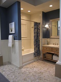 Navy Walls With White Almond Bath Fixtures Bathroom
