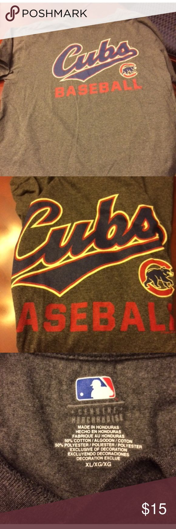 Like New Men's Cub T Shirt No holes no tears no rips's in like new condition comes from a smoke free home. I bought this for my husband he wore it maybe one time and then it's been sitting in the closet ever since. I bought this from Navy Pier in ChicAgo. This is genuine MLB merchandise. Tops Tees - Short Sleeve