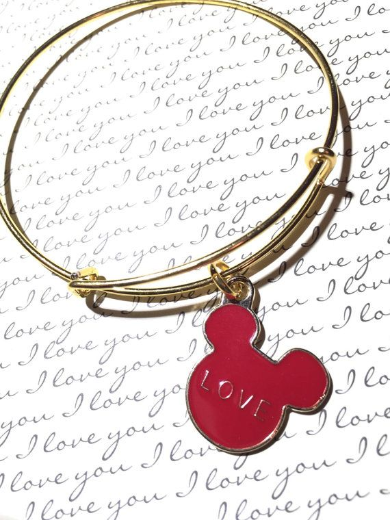 Mickey Mouse bangle Mickey inspired Disney inspired Mickey Mouse jewelry love Mickey Mouse Valentines Day  A red enamel Mickey charm adorns this gold bangle. The back of the charm is gold tone. Great for Valentines Day, or the Mickey Mouse lover in your life. Thank you for looking at my little shop