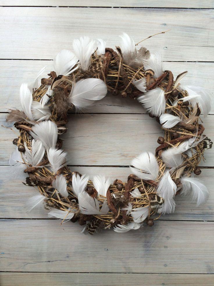 Feather bohemian Christmas wreath by MistyGypsy on Etsy https://www.etsy.com/listing/257278530/feather-bohemian-christmas-wreath