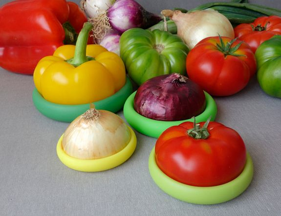 Food Huggers - The round silicone caps fit onto the ends of sliced fruits and vegetables to keep them fresh.
