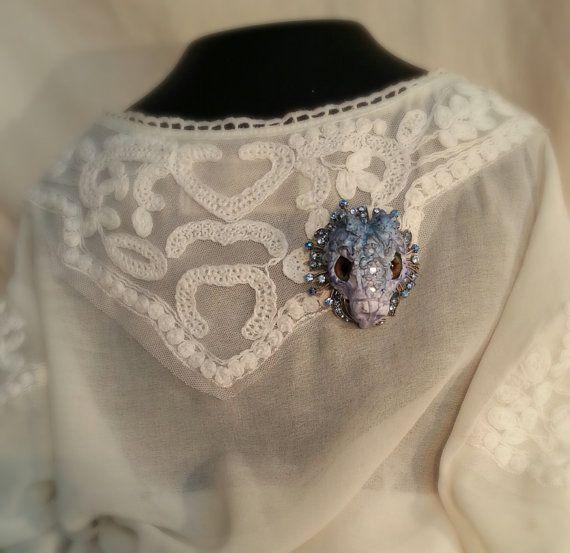 Dragon head brooch in blue shades