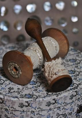 lace on wooden spools