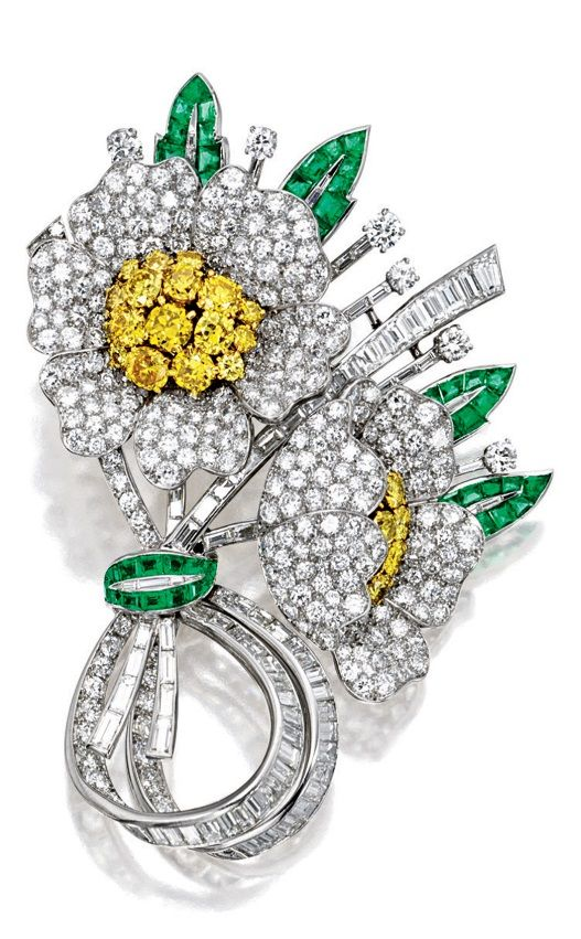 VAN CLEEF & ARPELS - AN IMPORTANT VINTAGE DIAMOND, YELLOW DIAMOND AND EMERALD BROOCH, CIRCA 1947. Designed as a stylised posy, the flower petals pavé-set throughout with brilliant-cut diamonds, embellished with circular-cut yellow diamond pistils, the swivelled stalks set with circular-cut and tapered baguette diamonds, further enhanced by calibré-cut emerald leaves, the diamonds and emeralds, mounted in platinum and 18 karat yellow gold, signed and numbered, with maker's mark of Max…
