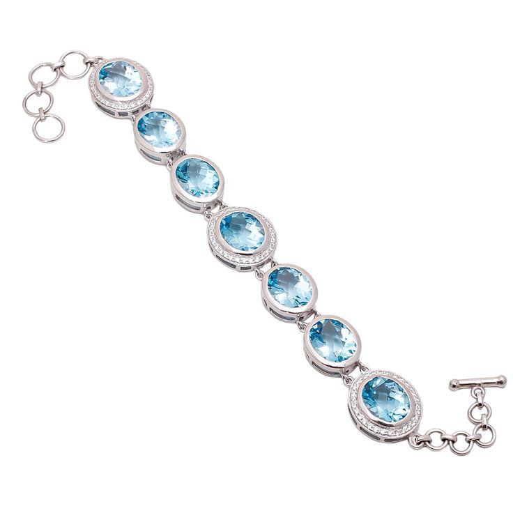 Blue Topaz Bracelet with american diamonds in sterling silver.