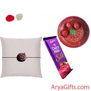 Send the best rakhi wishes to your dearest brother and show how much you will miss them on this Raksha Bandhan. This Rakhi hamper contains 1 Designer Rakhi and Cadbury Dairy Milk Fruit and Nuts (55 gm)and Pooja Thali . Rakhi design may differ as per the stock available. We offer free pack of Roli & Chawal along with Rakhis.