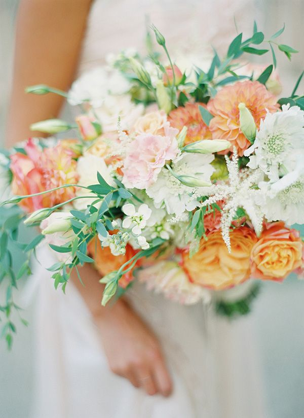 Bouquet Full of Roses, Dahlias, Astilbe, and Hellebore | Peaches & Mint Photography | A Blooming Spring Wedding full of Lush Flowers in Peach and Fresh Green - http://heyweddinglady.com/blooming-spring-wedding-full-of-lush-flowers/