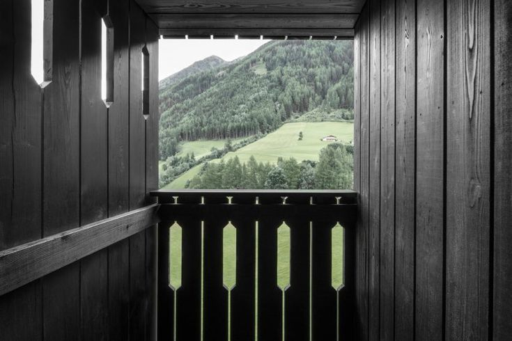 Pedevilla Architects adds blackened-larch extension to hotel in South Tyrol
