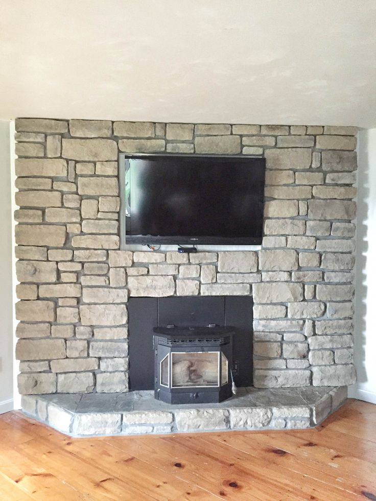 Brick fireplace makeover | Brick to stone veneer fireplace makeover | How to do a stone veneer fire place | GinaKirk.com