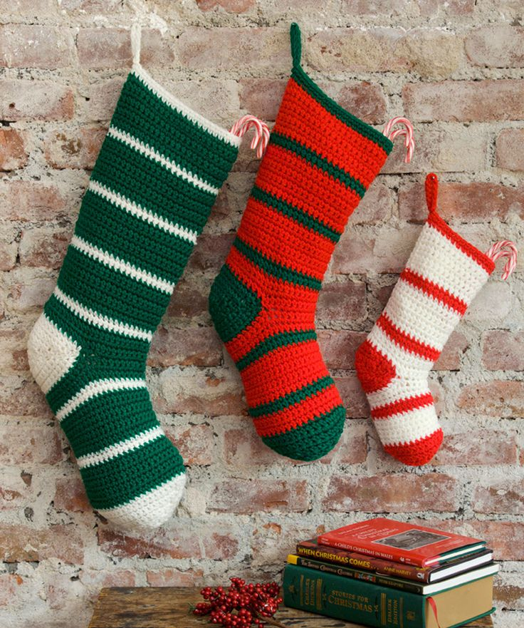 Here is a simple striped stocking that comes in papa, mama and child sizes. Crochet them for the whole family and create a personal tradition as you hang them each year.
