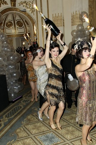 Perfect for flash mob! Sparklers in champagne bottles. Also a cool prop for the photo booth?