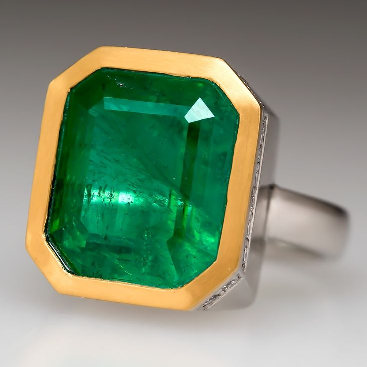The massive 14 carat emerald is set in a rich 22k yellow gold bezel atop a heavy solid platinum mounting. An emerald of this size and quality is quite a sight to see and is sure to make for a great conversation piece.