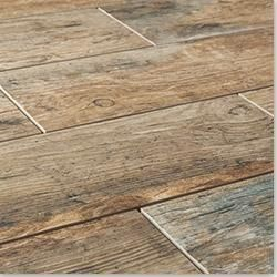 The look of wood and durability of tile. Can be a solution to a high traffic area or a damp location.