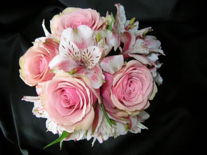 Bridesmaid's bouquet with pink roses and bi-colored pink alstroemeria.