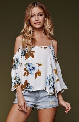 "The women's Off Shoulder Top by House of Harlow offers a bold floral print throughout and adjustable straps. We love the flowy fit and cropped cut. Bring out the boho vibes with this chic top paired with our high waisted denim shorts. 18"" length. Measured from a size small. Model is 5'9"" and wearing a small. 100% rayon. Hand wash only. Imported."