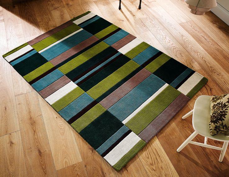 Handmade using 100% premium wool fibre, this Jazz Blocks Green Rug is a beautiful floor element for your room. #greenrugs #greenwoolrugs #woolrugs #modernrugs #luxuryrugs