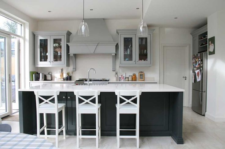 New York Modern Kitchen Design Ideas with grey cupboard and white dinner chairs