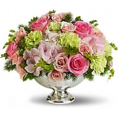 A gorgeous garden of dazzling pink and green wedding flowers arranged in a Mercury Glass Bowl is sure to delight.