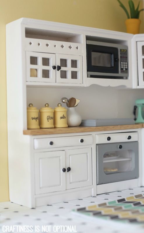 DIY dollhouse by craftiness is not optional. Great ideas for updating my old dollhouse.