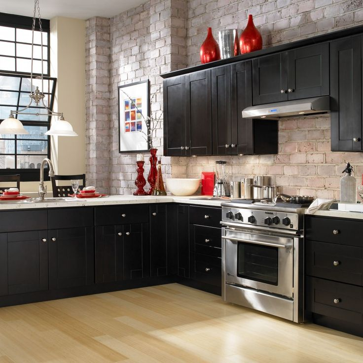 Brick backsplash and wall in the kitchen. I would not do any of the red or modern elements, but I ...