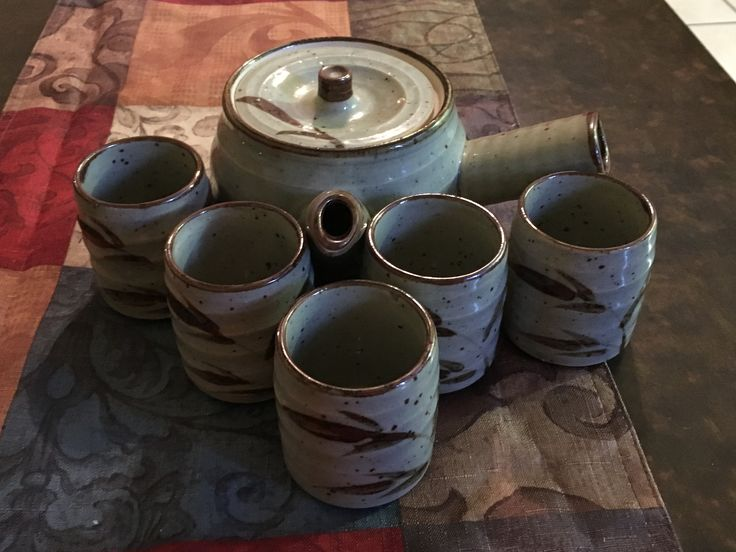 Hand thrown Japanese antique tea set  From the pretty peacock