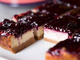 Blackberry Cheesecake Squares : Ree adds pecans to her buttery cookie crust for a subtle crunch and welcome nutty flavor. And she blankets the rich cream cheese-sour cream center with a sweetened blackberry sauce.